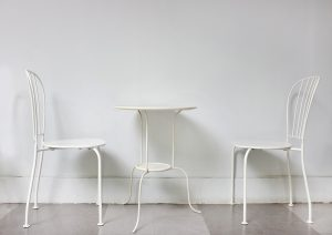 Two white chairs facing each other at a white table. Counseling and therapy in Indianapolis, IN for addiction and eating disorders. Drug counseling with an expert therapist in Indianapolis, in