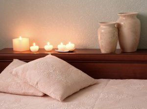 Luxury pillow, vases and candles in a low lit room. Therapy for couples, families and individuals at Northside Mental Health in Indianapolis, IN. 46220