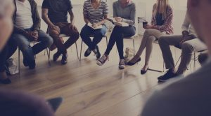 People sitting in a circle for group counseling with a mental health therapist in Indianapolis, IN