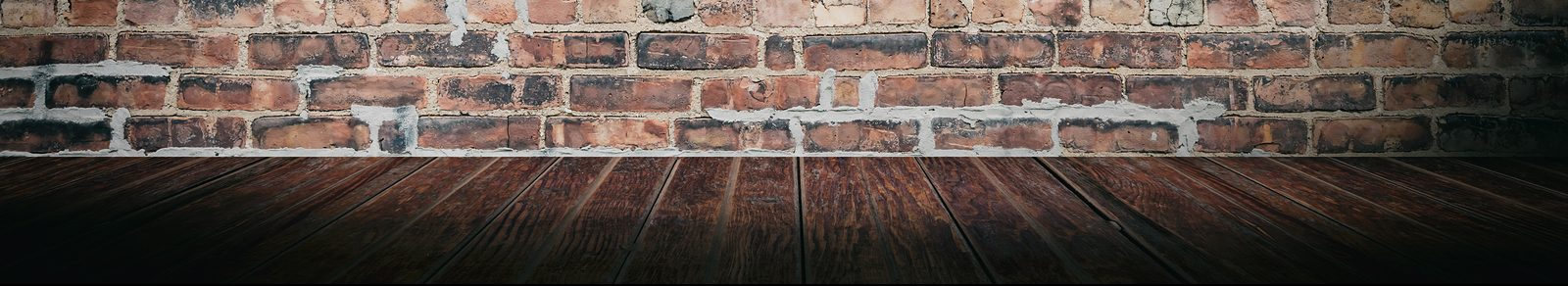 Brick wall and wood floor, modern and clean space for therapy for addictions, eating disorders, trauma & more with our skilled counselors in Indianapolis, Indiana