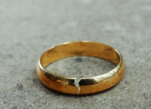 Cracked gold wedding ring after an affair, divorce or infidelity. Help for affair recovery is possible at Northside Mental Health in Indianpolis, IN 46220