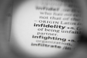 The word infidelity in a dictionary. You can get help for affair recovery and infidelity counseling at Northside Mental Health in Indianapolis, IN 46220